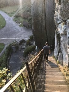 walking down from the top of the stone formation