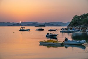 sunrise in Skiathos with boats in the foreground