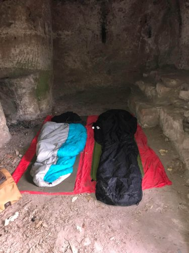 our sleeping bags in a castle room